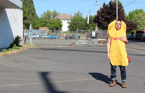 Enrico D. Wey in a twinkie costume in an abandoned hostess factory parking lot in Portland, photo: Lucy Lee Yim